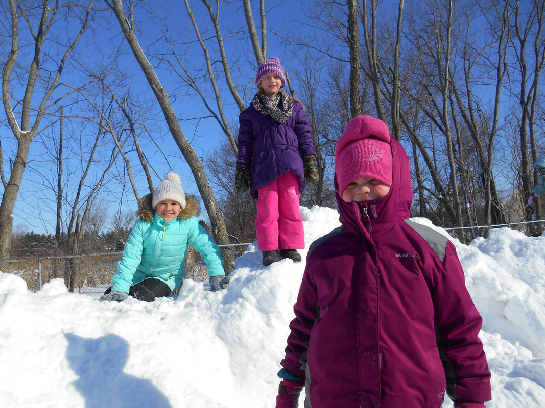 snow children playing outside school